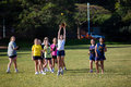 Softball practice girls catching for teenage girl yellow ball for fielding skills at port natal durban schools with their training Royalty Free Stock Photos