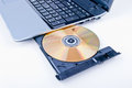 Software the cd or dvd entering for loading in laptop Stock Photo