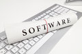 Software written on newspaper on desk Stock Photo