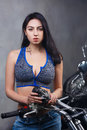 Soiled young beautiful woman repairs chopper Royalty Free Stock Photo