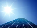Solar cell energy grid in sun and sky background Royalty Free Stock Photo