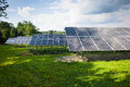 Solar collectors an array of in partial sunlight Royalty Free Stock Image