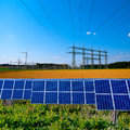 Solar, electric substation and power lines Stock Photo