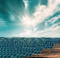 Solar electricity plant under blue sky Royalty Free Stock Image