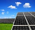 Solar energy panels against blue sky with clouds Royalty Free Stock Photo