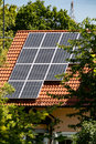 Solar energy panels mounted on a house roof Royalty Free Stock Photo