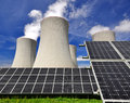 Solar energy panels before a nuclear power plant Royalty Free Stock Photo