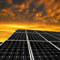 Solar energy panels in the setting sun Royalty Free Stock Photography