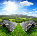 Solar energy panels in spring landscape Royalty Free Stock Photo