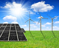 Solar energy panels and wind turbines spring meadow with Stock Images