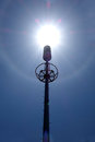 Solar flare telecommunication tower with under bue sky Royalty Free Stock Photo