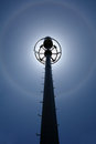 Solar flare telecommunication tower with under bue sky Stock Photo