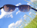 Solar glasses and sky 3 Royalty Free Stock Photography