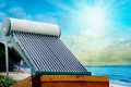 Solar heater for green energy on the background of sun and clouds Stock Photos