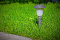 Solar Lantern is on the green lawn Royalty Free Stock Photo