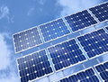 Solar Panel Against Blue Sky Stock Photo