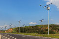 Solar  panel on electric pole on highway, use of Solar energy fo Royalty Free Stock Photo