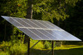 Solar Panel in a Forest Sunbeam Royalty Free Stock Photography