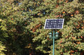 Solar panel and lights on trees background Stock Photo