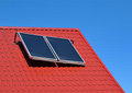 Solar panel on a red roof blue sky Royalty Free Stock Images