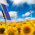 Solar panel and wind turbine Stock Photos