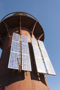 Solar panels attached to a beacon several lighthouse produce power in order keep the light on Royalty Free Stock Images
