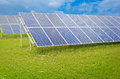 Solar panels blue in a green field Stock Photos