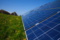 Solar panels, blue sky and green grass Royalty Free Stock Photo