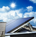 Solar panels on a building panel against blue sky Royalty Free Stock Photos