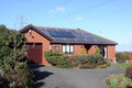 Solar Panels on Bungalow Roof Stock Photos