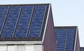 Solar panels on family houses close up of producing alternative energy Stock Photography