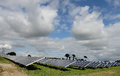 Solar panels in field scenic view of array of countryside with cloudscape background Stock Image