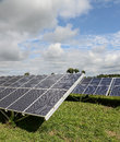 Solar panels in field scenic view of countryside Royalty Free Stock Photos