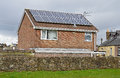 Solar panels fitted to the roof of a house Royalty Free Stock Image