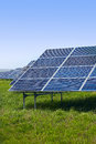 Solar panels on a green field on a sunny day Royalty Free Stock Photo
