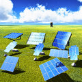 Solar panels on green grass with blue sky Stock Photos