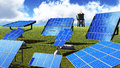 Solar panels on green grass with blue sky Stock Image