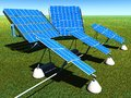 Solar panels on green grass with blue sky Royalty Free Stock Image