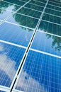 Solar panels with green reflection Royalty Free Stock Photo