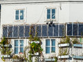 Solar panels on a house cells for use of energy residential alternative energy for townhouses Stock Images