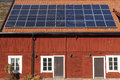 Solar panels on a house photovoltaic the roof against blue sky Royalty Free Stock Photography