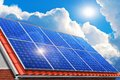 Solar panels on house roof creative power generation technology alternative energy and environment protection ecology business Stock Photo