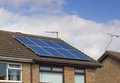 Solar panels on modern house the roof of semi detached copy space in sky Stock Images