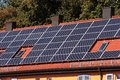 Solar panels old building energy re manufacturing with Stock Photo