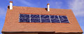 Solar panels photovoltaic or on a roof of house Stock Photos