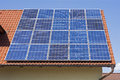 Solar Panels on the Red House Roof. Solar Energy Background.