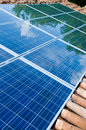 Solar panels on roof with green reflection Royalty Free Stock Photo