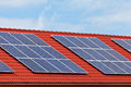 Solar panels on the roof of newly build houses Royalty Free Stock Images