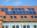 Solar panels on the roof of the school building Royalty Free Stock Photo
