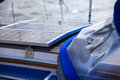 Solar panels in sailboat renewable eco energy charging batteries aboard a sail boat photovoltaic concept Royalty Free Stock Photo
